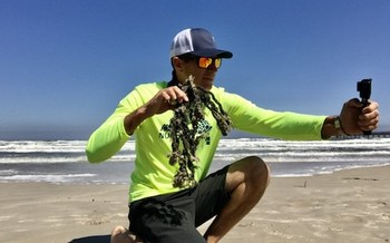 Jace Tunnell, director of the Mission-Aransas National Estuarine Research Reserve, holds rope debris he found as he prepares to record the reserve's weekly beach-combing video. (Mission-Aransas NERR)
