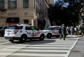 Police in Washington block a road to the White House during recent protests after the death in Minneapolis of George Floyd. (Adobe Stock)