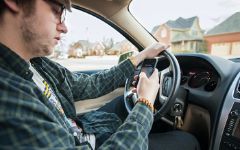 The Idaho State Police say one-in-five crashes in the state involves distracted driving. (chuchi25/Adobe Stock)