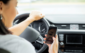 South Dakota's Department of Public Safety says 827 crashes across the state last year were attributed to distracted driving with an electronic device. (Adobe Stock)