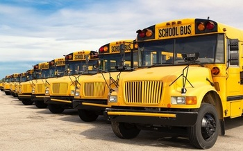 School bus drivers say it's difficult for them to prevent close contact between themselves and their students on their daily routes. (pyzata/Adobe Stock)