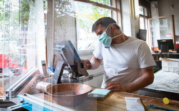 Wisconsin and more than 30 other states now require face masks in most public settings amid a resurgence of the coronavirus. (Adobe Stock)