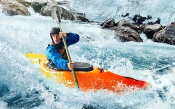 Whitewater kayaking is one of dozens of activities outdoor enthusiasts participate in on public lands in states in the Mountain West. (VAIR PRO/Adobe Stock)