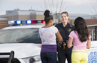 Research shows allowing police officers to handle minor infractions in schools often marks a student's first contact with the criminal justice system, potentially setting them up for a lifetime of collateral consequences. (Adobe Stock)