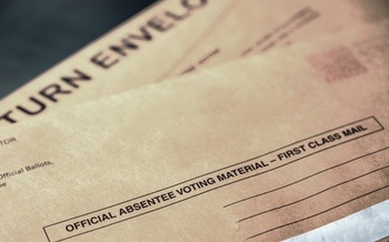The Ohio Secretary of State wants to use revenue from the office's Business Services Division to cover the cost of prepaid postage on absentee ballots. (AdobeStock)<br /><br />