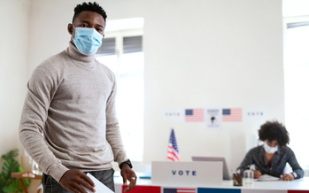 Be prepared for delays when early voting in Baltimore. As a precaution, the city will be checking temperatures at Voting Centers. (Adobe stock)