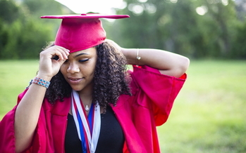 A new report shows that Black women hold almost 50% more student loan debt than white men. (Adobe stock)