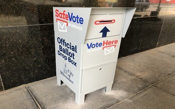 The City of Milwaukee has more than a dozen absentee ballot drop boxes across the city. Wisconsin voters who have yet to turn in absentee ballots are urged to find a drop-off site rather than mail them. (urbanmilwaukee.com)