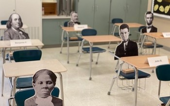 Filling empty chairs with cutouts of historical figures makes social distancing a learning tool. (Photo: Joe Welch)