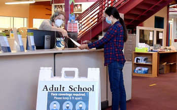 Marina Kravtsova now helps students register for San Mateo Adult School, where she graduated. (Shellye Chen)