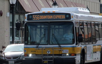 The Massachusetts Bay Transportation Authority is cutting 20 bus routes and consolidating or shortening 16 additional routes. (Wikimedia Commons)