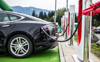 With the Transportation and Climate Initiative, revenue paid by gasoline and oil companies for pollution will help fund clean-power infrastructure such as electric car charging stations. (dandaman/Adobe Stock)