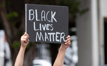 Boston is one of the many cities across the country that erupted in protests over police brutality this summer. More than half a year later, a police reform bill nears passage in the General Court. (Fitz/Adobe Stock)