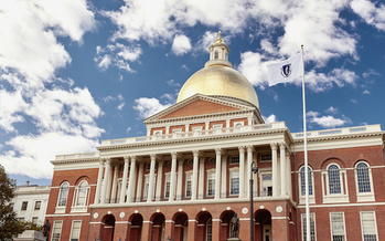 Although still present at the Massachusetts State House, city council buildings in some municipalities have opted to remove the state flag, a symbol that many have sought to update for more than 30 years. (Jen Lobo/Adobe Stock)