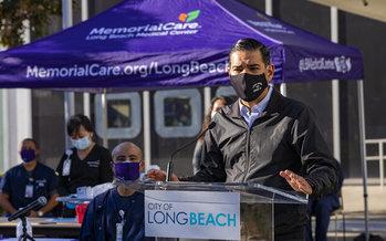 Long Beach Mayor Robert Garcia addresses people at one of the city's vaccine clinics. Long Beach has a large LGBTQ+ community. (City of Long Beach)