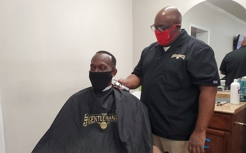 Gentleman's Grooming Lounge owner Derek Brooks is comfortable speaking with clients about heart health. (American Heart Association)<br />