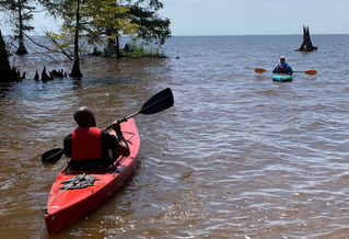 Bertie County Manager Juan Vaughan II and retired county manager Scott Sauer take to the water during the Bertie Beach grand opening in June 2019. (Sarah Tinkham/TGOW)<br />