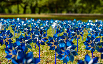 A symbol for Child Abuse Prevention Month, pinwheels represent the playfulness of childhood. (Fotoluminate LLC/Adobe Stock)