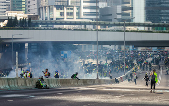 Protestors clash with police on a highway in Hong Kong. (Adobe Stock)