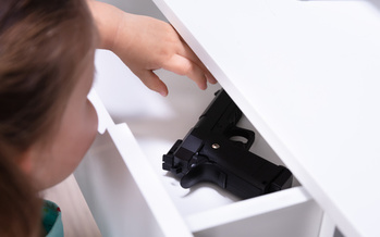 The American Public Health Association says 40% of gun-owning households with children store firearms unlocked, which contributes to the 2,700 children injured by gunfire and 110 fatal unintentional shootings every year. (Adobe Stock)