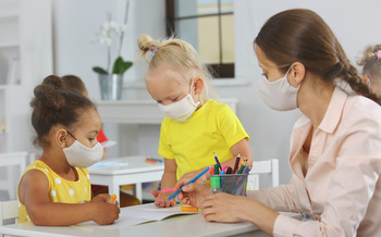 The pandemic has put added stress on the child-care workforce across the country. In Washington state, it caught the attention of legislators, who've included more money for pay and health benefits in the new state budget. (ShunTerra/Adobe Stock)