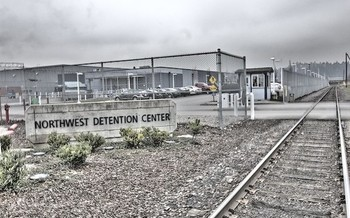 A measure passed in Olympia this session means the GEO Group-owned Northwest Detention Center will shut down when its contract expires. (Common Language Project/Flickr)