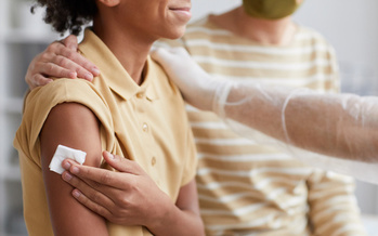 Massachusetts has launched efforts to reduce racial and socioeconomic disparities in vaccination rates, but while some communities' rates are through the roof, others still lag behind.  (Seventyfour/Adobe Stock)