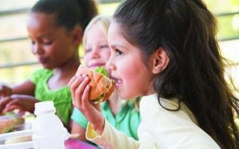 PHOTO: Girl eating a sandwich.