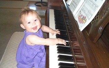 PHOTO: Child playing a piano. Photo credit: Deborah Smith