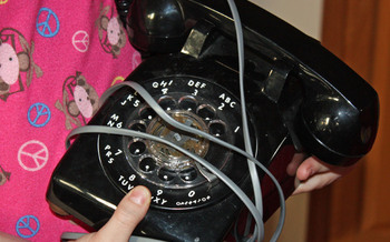 PHOTO: old telephone wrapped in cord. Photo Credit: Deborah Smith