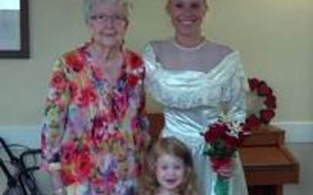 PHOTO: Maple Creek resident with daughter modeling her wedding dress.  Credit: Lutheran Social Services of Michigan