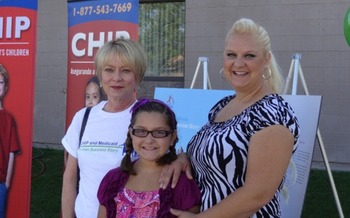 Joy Pizzuto (R) and her daughter Annabella agreed to be part of the story collection. They are seen  here with Karen Crompton (L), president and CEO, Voices for Utah Children.<br />