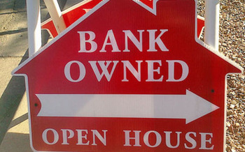 PHOTO: Bank owned sign. Photo credit: Deborah Smith