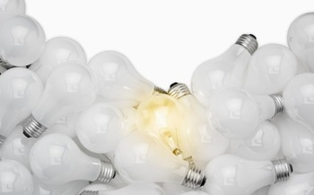 PHOTO: Unlike incandescent bulbs, you can't just throw lower energy CFL light bulbs in the trash.  Image by © Royalty-Free/Corbis
