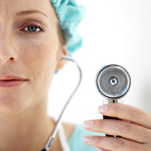 PHOTO: Female doctor with stethoscope.