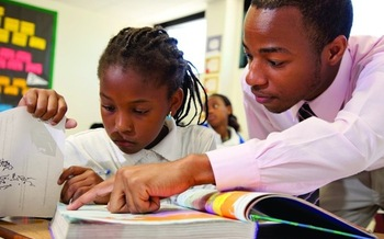 PHOTO: teacher helping a student, courtesy of Teach for America Eastern Carolina