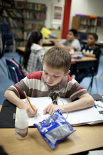 PHOTO: A student at Old Mill Middle School North in Millersville, MD, studies while enjoying school breakfast.