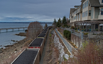 PHOTO: A train loaded with coal on the Bellingham tracks, near homes and Boulevard Park. Photo credit: Paul K. Anderson
