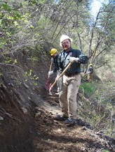 PHOTO: Sam Stripes does trail work on the Uinta-Wasatch-Cache National Forest. Photo credit: Sean Damitz.