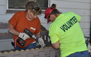 PHOTO: Volunteers working on a home last year for the National Day of Service. Courtesy of Habitat for Humanity of Laramie County.