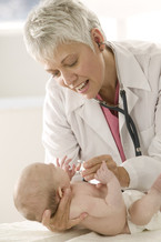 PHOTO: Doctor and baby. CREDIT: CDF-MN