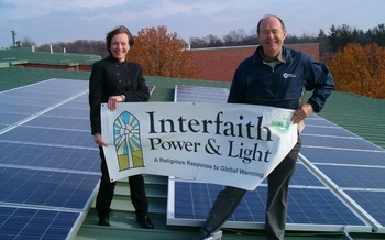 Julie Lyons Brinker and Dave Fredericks from MIFPL, standing on an Ann Arbor church roof. Photo credit: MIFPL
