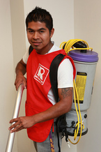 PHOTO: A contract office-cleaning crew member. Courtesy of 32BJ SEIU.