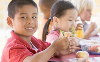 Photo: children eating at school program   Courtesy of frac.org
