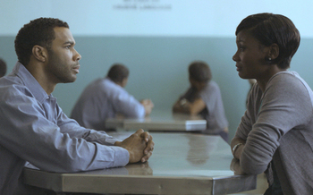 "PHOTO: Derek (Omari Hardwick) is visited in prison by his wife Ruby (Emayatzy Corinealdi) in ""Middle of Nowhere.""  Courtesy African American Film Festival Releasing Movement"