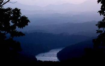 Photo: French Broad River in Asheville at dusk. Courtesy of Riverlink