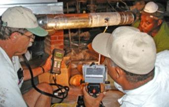 PHOTO: Men testing a furnace.