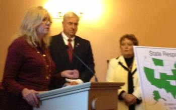 PHOTO: Picture of Marla Root at a Statehouse conference introducing the new legislation.