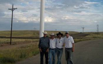 PHOTO: Nate Sandvig (2nd from left) and his project team at a windfarm site. Courtesy of Sandvig.