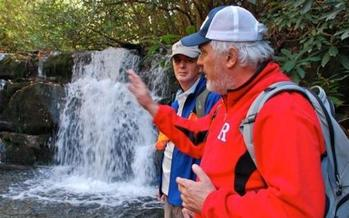 Jeff Hunter shows a stunning waterfall to writer Chris Dortch in the Cherokee National Forest (Photo: Jeff Guenther)